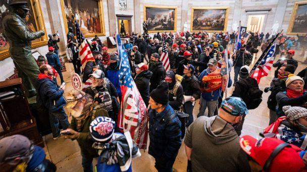 PHOTO: Supporters of President Donald Trump run through the Rotunda of the US Capitol after breaching Capitol security during their protest in Washington, on Jan. 6, 2020. (Jim Lo Scalzo/EPA via Shutterstock)