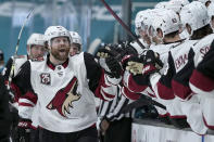 Arizona Coyotes right wing Phil Kessel (81) celebrates with teammates after scoring a goal against the San Jose Sharks during the third period of an NHL hockey game Friday, May 7, 2021, in San Jose, Calif. Arizona won 5-2. (AP Photo/Tony Avelar)