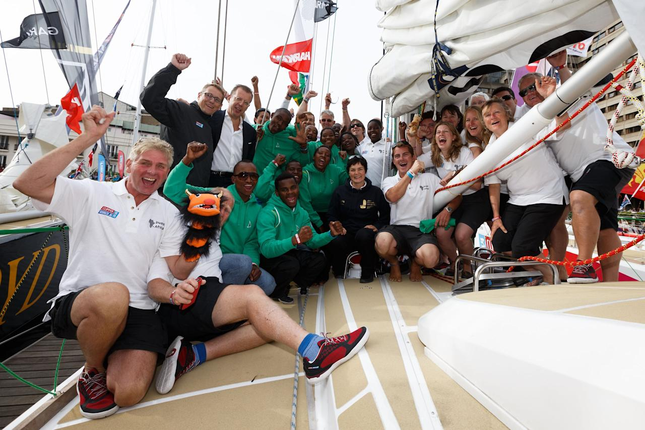 Dame Ellen McCarther poses for a photograph with the Invest Africa crew during the start of the Clipper Round the World Race in London.