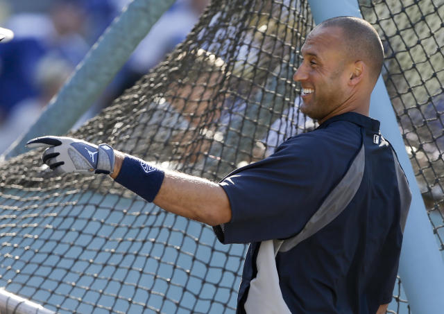 New York Yankees shortstop Derek Jeter smiles during batting practice before a baseball against the Los Angeles Dodgers in Los Angeles, Tuesday, July 30, 2013. (AP Photo/Chris Carlson)
