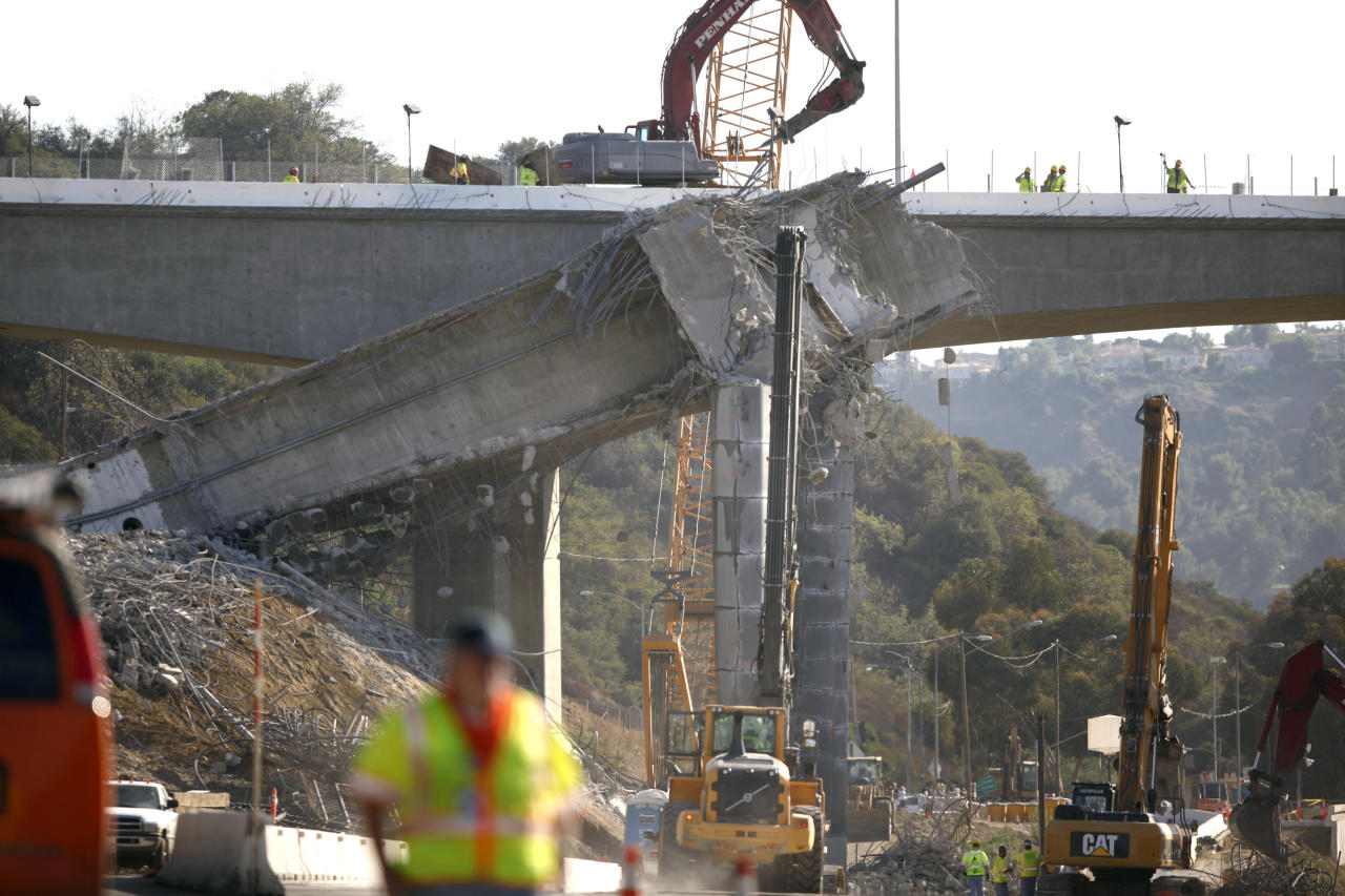 Workers continue the demolition of the center span of the Mulholland Drive bridge along Interstate 405 in Los Angeles on Saturday Sept. 29,2012. Construction crews are on schedule and traffic tie-ups are minimal in Los Angeles, making for a smooth start to Carmageddon II, the sequel to last year's shutdown of one of the nation's busiest freeways. (AP Photo/Richard Vogel)