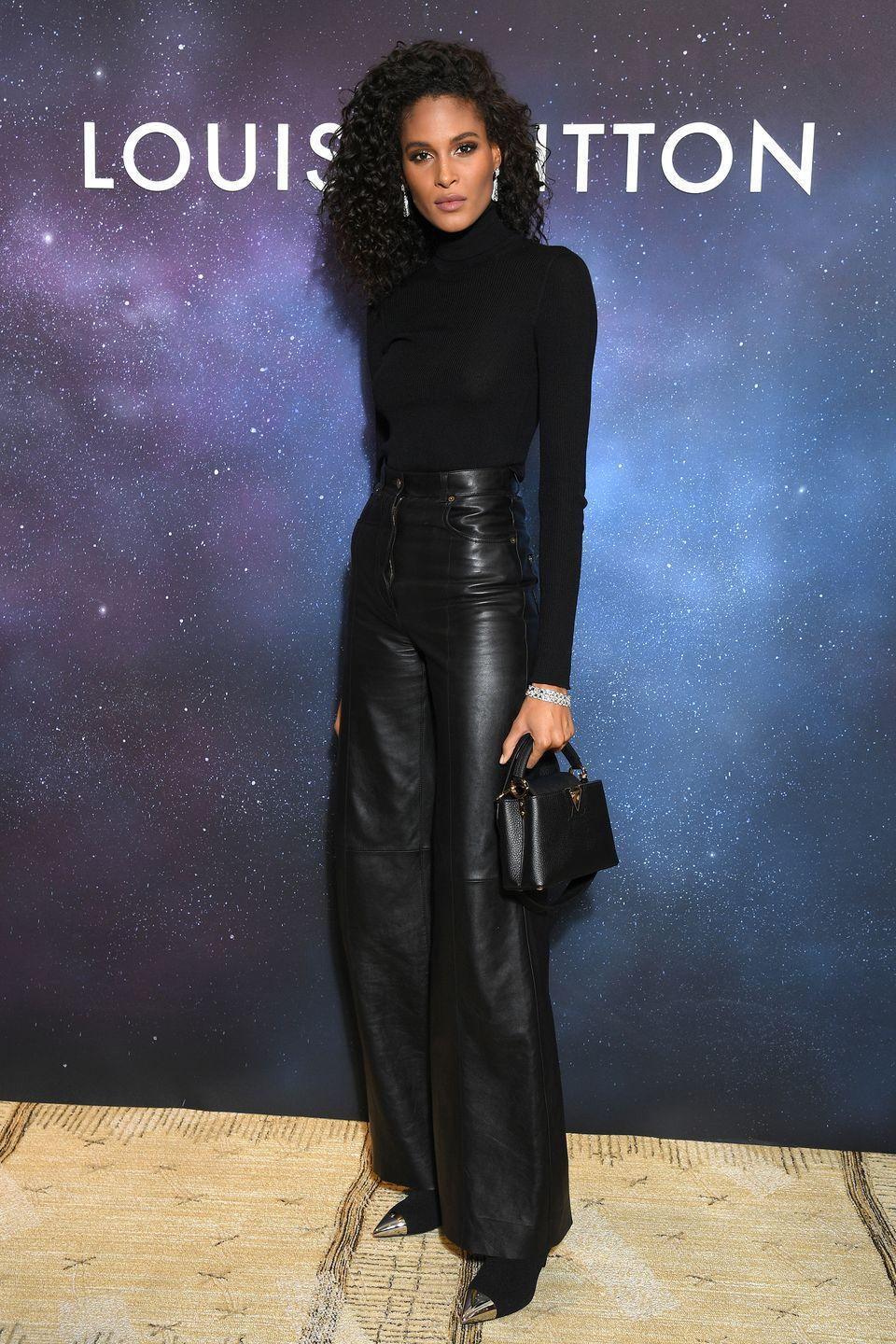 <p><strong>28 September </strong>French model Cindy Bruna kept things classic in a black poloneck and leather wide-legged trousers. </p>