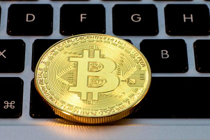 SPAIN - 2021/02/23: In this photo illustration, a Bitcoin is seen on the background of a computer keyboard. (Photo Illustration by Thiago Prudêncio/SOPA Images/LightRocket via Getty Images)