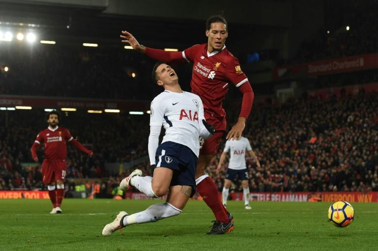 Liverpool's 2-2 draw with top-four rivals Tottenham Hotspur came when Spurs were awarded two controversial penalties, the second for a foul by Virgil Van Dijk (R) on Erik Lamela
