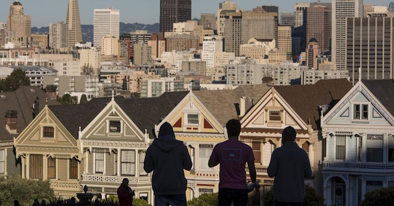 Victorian homes and the downtown skyline in San Francisco, California.