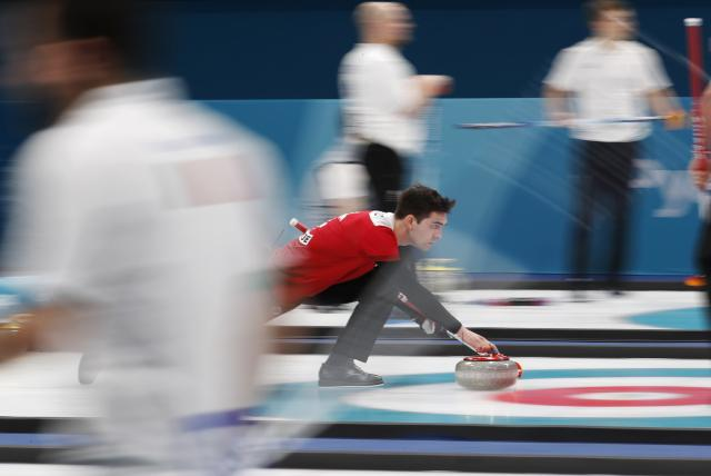 Curling - Pyeongchang 2018 Winter Olympics - Men's Round Robin - Switzerland v Norway - Gangneung Curling Center - Gangneung, South Korea - February 17, 2018 - Peter de Cruz of Switzerland delivers a stone. REUTERS/Cathal McNaughton