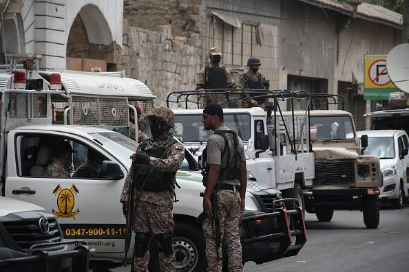 Police officers inspect the site after gunmen attacked the Pakistani stock exchange building in Karachi, Pakistan.