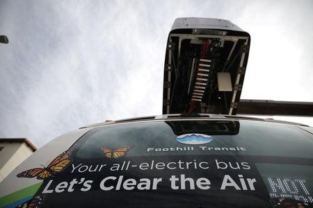 An electric bus sits under a charging station in Azusa, California U.S. November 16, 2017. REUTERS/Lucy Nicholson