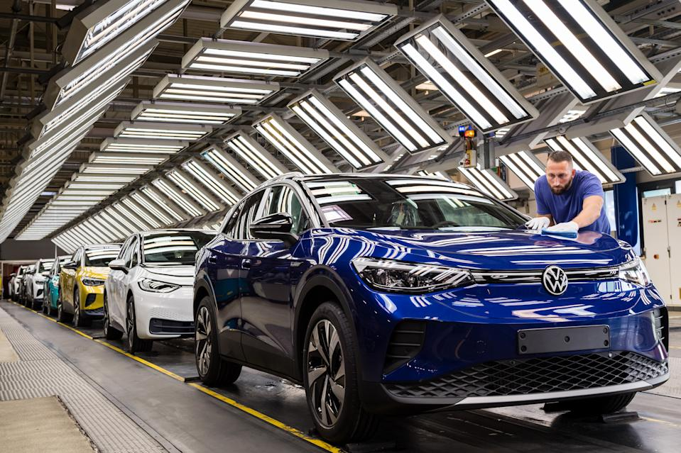 ZWICKAU, GERMANY - SEPTEMBER 18: Workers assemble the new Volkswagen ID.4 electric sport utility vehicle (SUV) at the VW factory on September 18, 2020 in Zwickau, Germany. Volkswagen will officially present the ID.4 towards the end of September. In addition, Volkswagen also produces the smaller ID.3 at the Zwickau plant. Both cars are meant to lead the company towards mass sales in the electric car market and provide it with strong competition against rival Tesla. (Photo by Jens Schlueter/Getty Images)