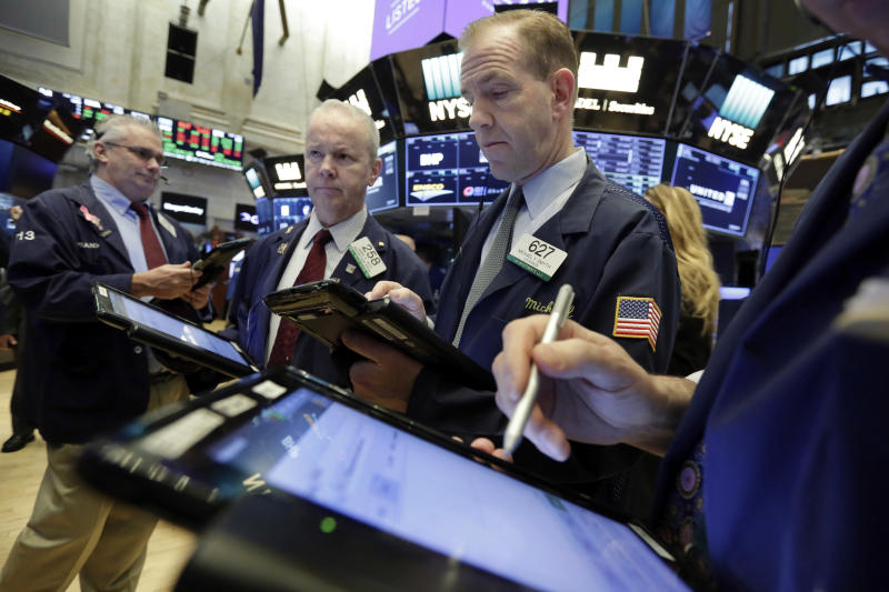 Traders Frank O'Connell, James Riley, and Michael Smyth, left to right, work on the floor of the New York Stock Exchange, Friday, Feb. 23, 2018. Stocks are opening higher on Wall Street, led by gains in technology companies and banks. (AP Photo/Richard Drew)