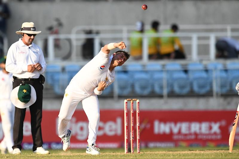 Pakistan's bowler Yasir Shah delivers a ball on day four of the first Test match between West Indies and Pakistan at the Sabina Park in Kingston, Jamaica, on April 24, 2017 (AFP Photo/Jewel SAMAD)