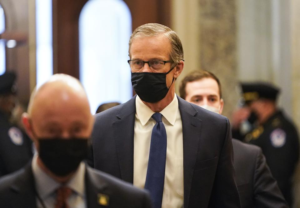 Senator John Thune, a Republican from South Dakota, arrives at the U.S. Capitol in Washington, D.C., U.S., on Wednesday, Feb. 10, 2021. (Joshua Roberts/Reuters/Bloomberg via Getty Images)