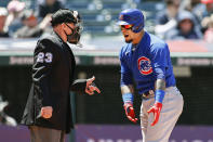 Chicago Cubs' Javier Baez argues a call with home plate umpire Lance Barksdale (23) during the third inning of a baseball game against the Cleveland Indians, Wednesday, May 12, 2021, in Cleveland. (AP Photo/Ron Schwane)