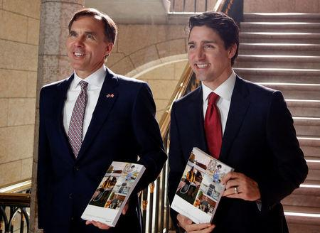 Canada's Prime Minister Trudeau and Finance Minister Morneau walk to the House of Commons to deliver the budget on Parliament Hill