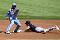 Cleveland Indians' Myles Straw, right, steals second base in front of Texas Rangers second baseman Andy Ibanez, left, during a baseball game in Arlington, Texas, Sunday, Oct. 3, 2021. (AP Photo/Matt Strasen)
