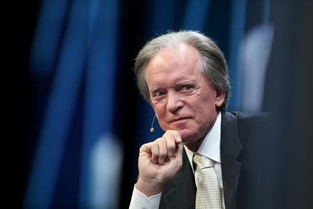 Janus Capital Group's Bill Gross listens during the Milken Institute Global Conference in Beverly Hills