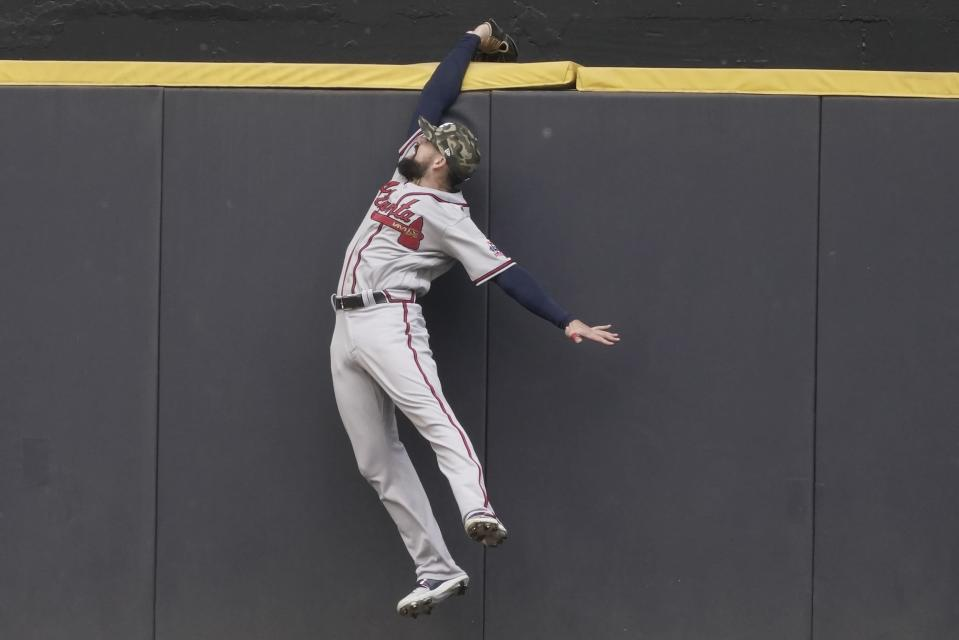 Atlanta Braves' Ender Inciarte fails to catch a two-run home run hit by Milwaukee Brewers' Avisail Garcia during the fifth inning of a baseball game Sunday, May 16, 2021, in Milwaukee. (AP Photo/Morry Gash)