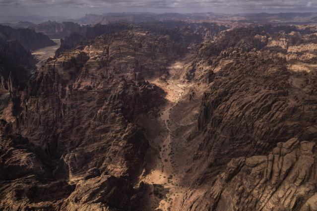 This Wednesday, Jan. 8, 2020 photo shows an overview of stage four of the Dakar Rally between Neom and Al Ula, in Saudi Arabia. Formerly known as the Paris-Dakar Rally, the race was created by Thierry Sabine after he got lost in the Libyan desert in 1977. Until 2008, the rallies raced across Africa, but threats in Mauritania led organizers to cancel that year's event and move it to South America. It has now shifted to Saudi Arabia. The race started on Jan. 5 with 560 drivers and co-drivers, some on motorbikes, others in cars or in trucks. Only 41 are taking part in the Original category. (AP Photo/Bernat Armangue)
