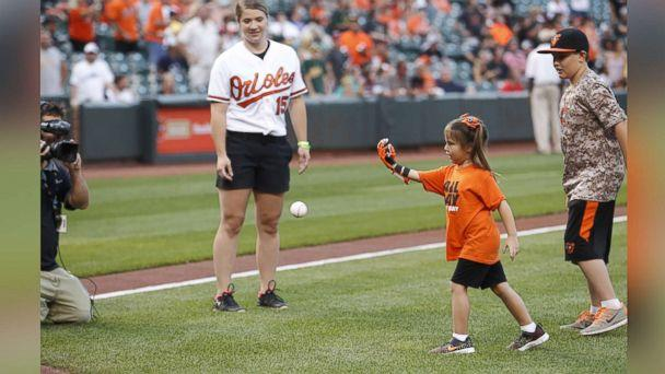 PHOTO: Hailey Dawson, a 7-year-old from Nevada, has thrown the first pitch with her 3-D printed hand for two major league baseball teams and hopes to reach her goal of 28 more. (Baltimore Orioles)