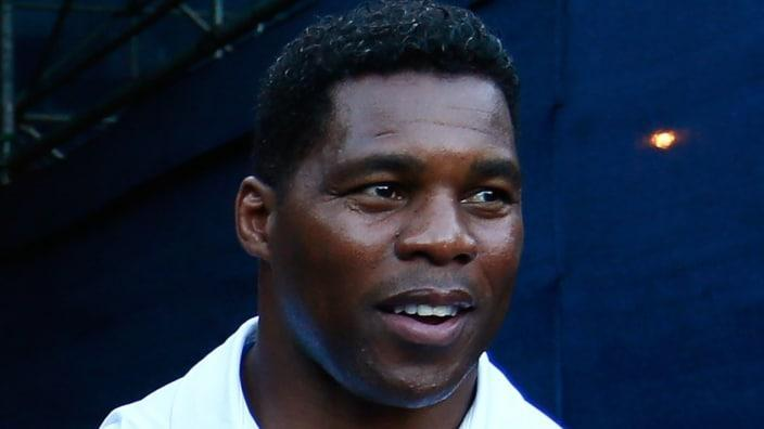 This 2014 photo shows former NFL star Herschel Walker walking onto Stadium Court for BB&T Atlanta Open at Atlantic Station. A third woman has emerged with claims that he threatened and stalked her. (Photo by Kevin C. Cox/Getty Images)