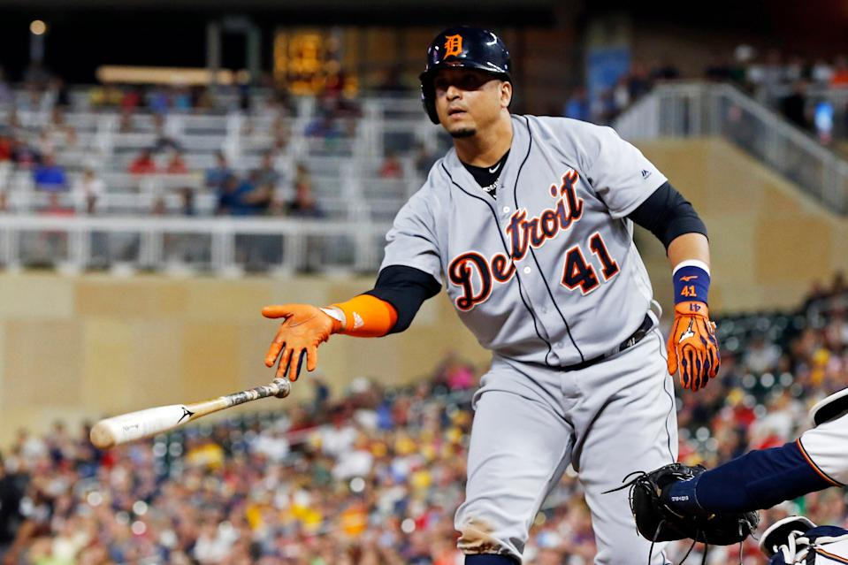 Detroit Tigers' Victor Martinez tosses his bat after drawing a bases-loaded walk from Minnesota Twins pitcher Trevor May during the fifth inning of a baseball game Thursday, Aug. 16, 2018, in Minneapolis.