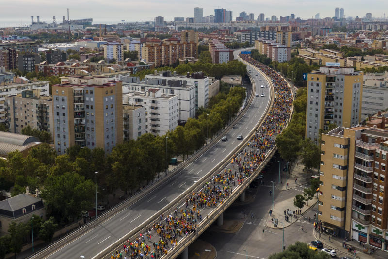 Pro-independence demonstrators march into the city on the fifth day of protests in Barcelona, Spain, Friday, Oct. 18, 2019. (Photo: Emilio Morenatti/AP)