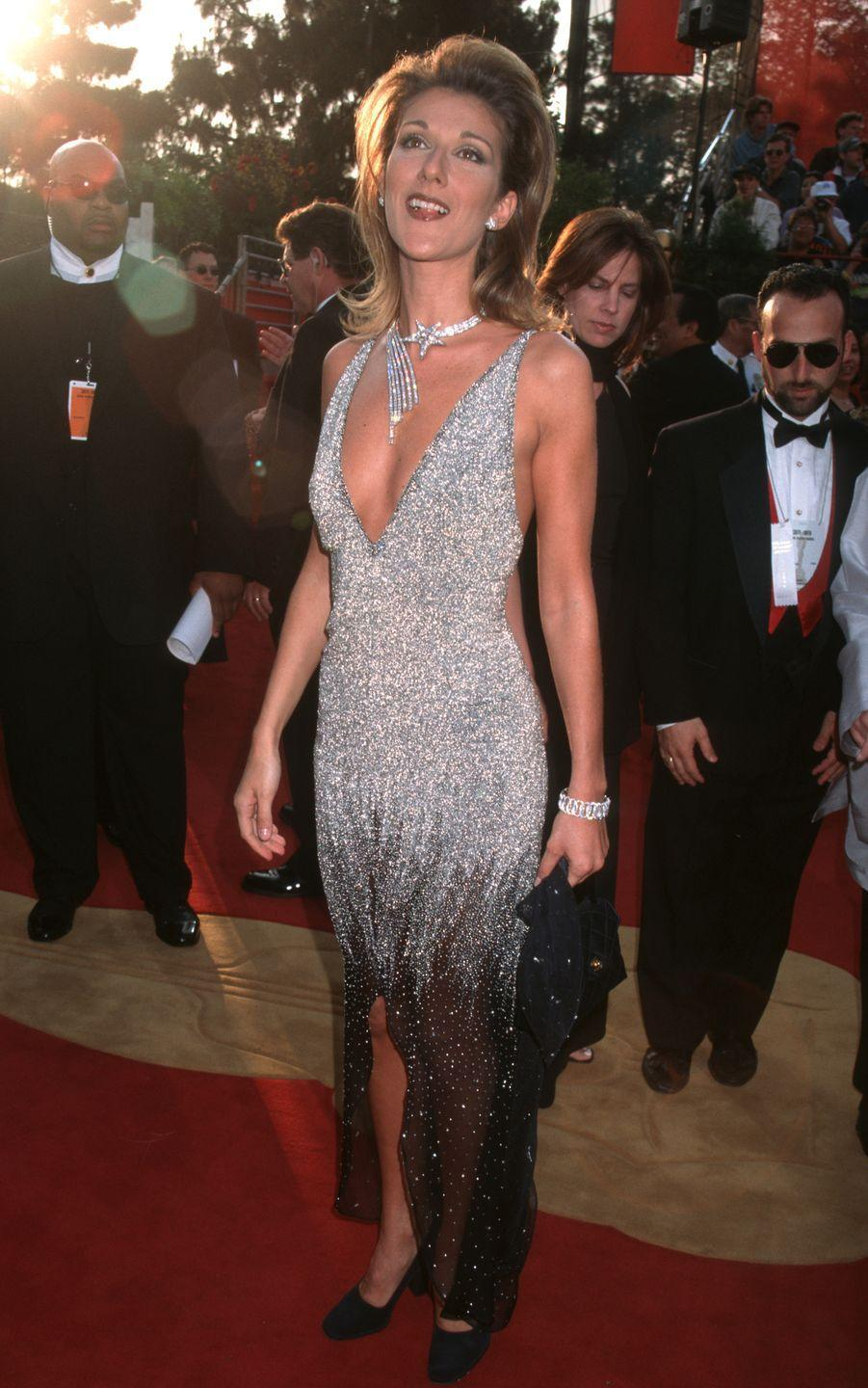 <p>If you couldn't tell by now, Dion has a penchant for sparkles. This plunging silver gown turned heads, and the added celestial necklace and earrings made the singer shine even more.</p>