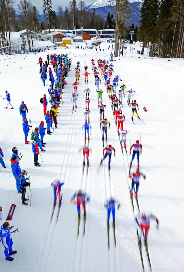 SOCHI, RUSSIA - FEBRUARY 09: Skiers compete in the Men's Skiathlon 15 km Classic + 15 km Free during day two of the Sochi 2014 Winter Olympics at Laura Cross-country Ski & Biathlon Center on February 9, 2014 in Sochi, Russia. (Photo by Richard Heathcote/Getty Images)