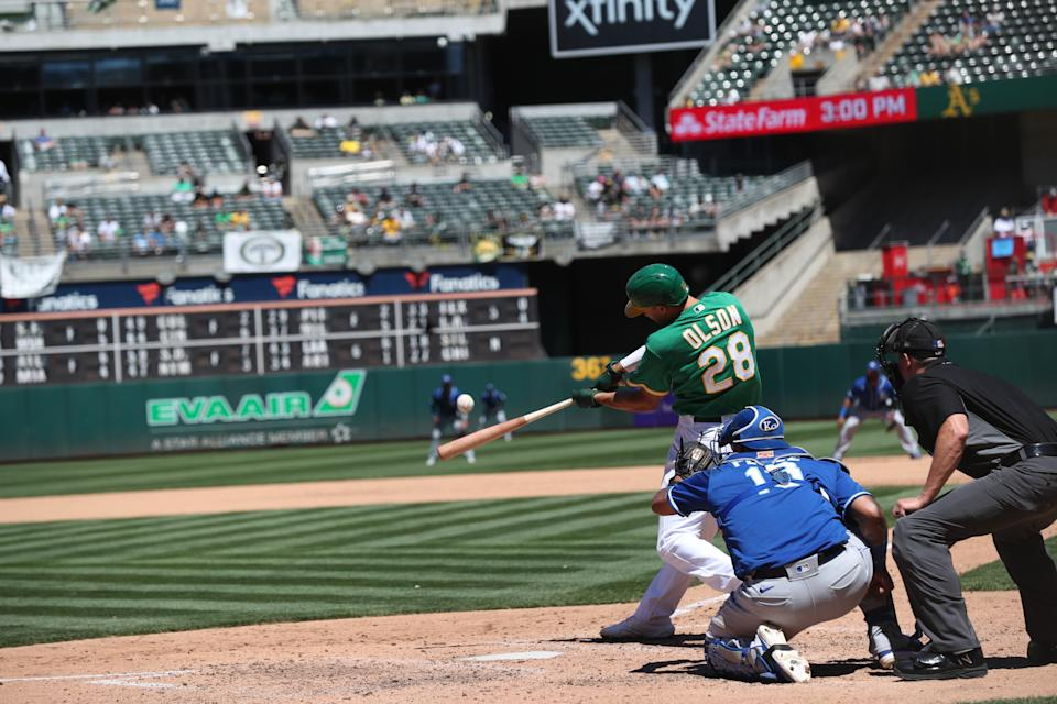 OAKLAND, CA - JUNE 13: Matt Olson #28 of the Oakland Athletics hits his second home run of the day during the game against the Kansas City Royals at RingCentral Coliseum on June 13, 2021 in Oakland, California. The Athletics defeated the Royals 6-3. (Photo by Michael Zagaris/Oakland Athletics/Getty Images)