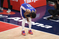 Philadelphia 76ers center Joel Embiid (21) reacts after he fell on the court during the first half of Game 4 in a first-round NBA basketball playoff series against the Washington Wizards, Monday, May 31, 2021, in Washington. (AP Photo/Nick Wass)