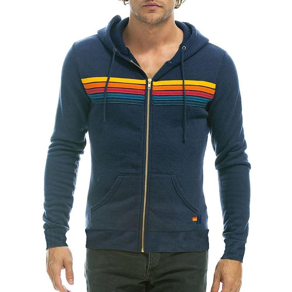 """<p><strong>HDRS5-NVY-XS</strong></p><p>aviatornation.com</p><p><strong>$189.00</strong></p><p><a href=""""https://www.aviatornation.com/collections/unisex-hoodies/products/5-stripe-hoodie-navy"""" rel=""""nofollow noopener"""" target=""""_blank"""" data-ylk=""""slk:BUY IT HERE"""" class=""""link rapid-noclick-resp"""">BUY IT HERE</a></p><p>Aviator Nation's retro cool clothing has the SoCal vibes you'll want to flex both on and off the beach. Their hooded sweatshirts are a standout with signature colored stripes and hand-stitched details. The brand prides itself on making each piece feel specially crafted with a worn-in look and feel that's sure to compliment the wearer. </p>"""