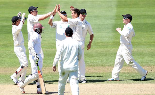 DUNEDIN, NEW ZEALAND - DECEMBER 05: Trent Boult of New Zealand is congratulated by his team-mates after taking the wicket of Shivnarine Chanderpaul during day three of the first test match between New Zealand and the West Indies at University Oval on December 5, 2013 in Dunedin, New Zealand. (Photo by Rob Jefferies/Getty Images)