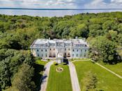 """<p class=""""body-dropcap"""">Anyone with a <em>bit</em> of spare change and an appreciation for architecture—or Taylor Swift—now has a chance to own Winfield Hall. The palatial estate located in Glen Cove, Long Island, which was featured in Swift's 2014 <a href=""""https://www.youtube.com/watch?v=e-ORhEE9VVg"""" rel=""""nofollow noopener"""" target=""""_blank"""" data-ylk=""""slk:""""Blank Space"""""""" class=""""link rapid-noclick-resp"""">""""Blank Space""""</a> music video, is set to be auctioned later this month. Although the original asking price was $20 million, the current starting bid ask is only $7 million—a 65% decrease. <br> <br>The 32,000-square-foot mansion overlooking the Long Island Sound was built in 1917 by famed architect C. P. H. Gilbert, who was commissioned by wealthy businessman (and founder of one of the first dollar stores in America) <a href=""""https://www.nytimes.com/2012/08/14/nyregion/the-stately-homes-of-a-five-and-dime-store-founder.html"""" rel=""""nofollow noopener"""" target=""""_blank"""" data-ylk=""""slk:Frank Winfield Woolworth"""" class=""""link rapid-noclick-resp"""">Frank Winfield Woolworth</a>. Upon its construction, the estate was said to be the largest home in America, according to the <em><a href=""""https://nypost.com/2021/07/06/fairy-tale-mansion-featured-in-taylor-swifts-blank-space-up-for-auction/"""" rel=""""nofollow noopener"""" target=""""_blank"""" data-ylk=""""slk:New York Post"""" class=""""link rapid-noclick-resp"""">New York Post</a></em>. Winfield died in Glen Cove just two years later in April 1919.</p><p>The estate was featured in a March 1920 edition of <em>Architectural Record</em>. Writer Herbert Croly stated, """"Notwithstanding the large number of rooms the plan is simple and convenient. The visitor enters through a spacious hall which runs through the house and leads straight to the formal garden on the other side."""" He went on to write, """"The interest of the Woolworth house is increased rather than diminished because of the fact that it belongs to a type of domestic architecture which is destined to disappear. """