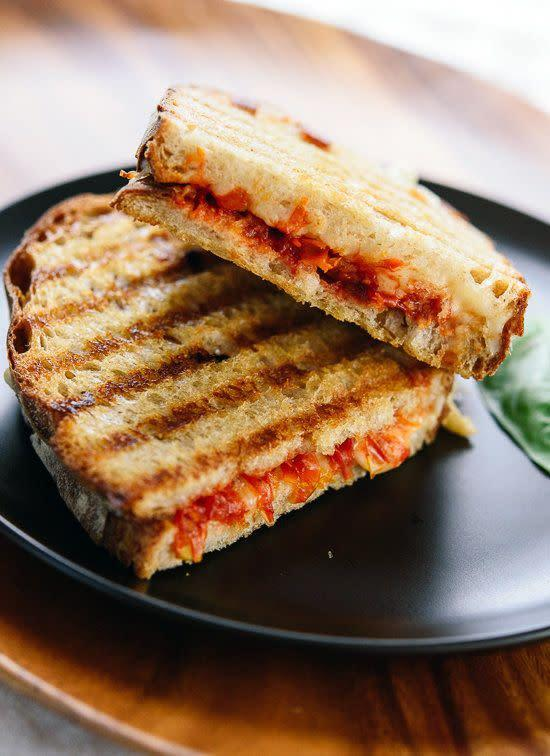 """<strong>Get the <a href=""""http://cookieandkate.com/2015/tomato-jam-and-mozzarella-panini/"""" rel=""""nofollow noopener"""" target=""""_blank"""" data-ylk=""""slk:Tomato Jam And Mozzarella Panini recipe"""" class=""""link rapid-noclick-resp"""">Tomato Jam And Mozzarella Panini recipe</a>&nbsp;from Cookie + Kate</strong>"""