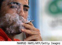Smokers such as this one keep puffing away in spite of skyrocketing tobacco taxes in places like Egypt and New York City.