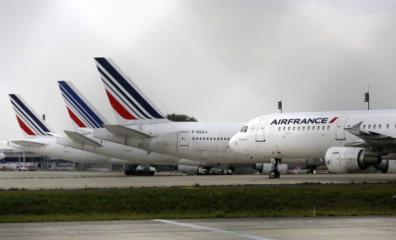 Air France planes are parked on the tarmac at the Charles de Gaulle International Airport in Roissy, near Paris on the second week of a strike by Air France pilots