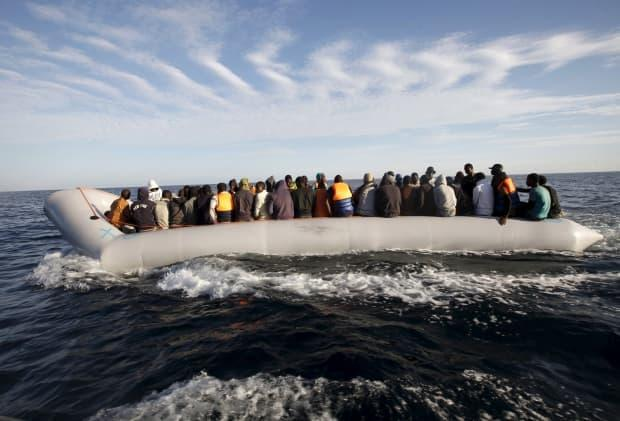 Migrants who tried to flee to Europe travel in a dinghy after they were stopped by the Libyan coast guard on September 29, 2015. The region is a major hub for human trafficking.