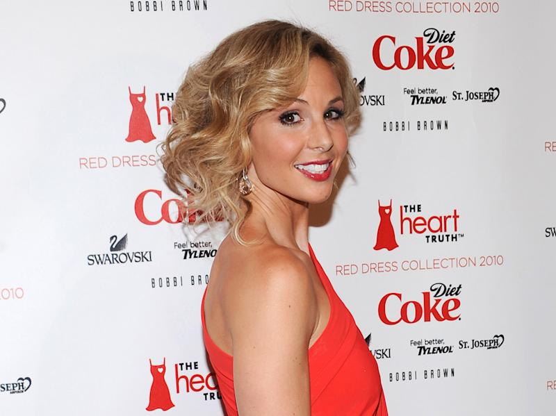 """FILE - This Feb. 11, 2010 file photo shows TV personality Elisabeth Hasselbeck at The Heart Truth's Red Dress Collection 2010 fashion show in New York. Hasselbeck debuts as Steve Doocy and Brian Kilmeade's new partner on """"Fox & Friends"""" Monday, Sept 16, 2013, after the departing Gretchen Carlson offered farewells on Friday. (AP Photo/Evan Agostini, file)"""