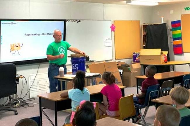 Bogalusa team member, Scot Martin, demonstrates the paper-making process for students at Wesley Ray Elementary School.