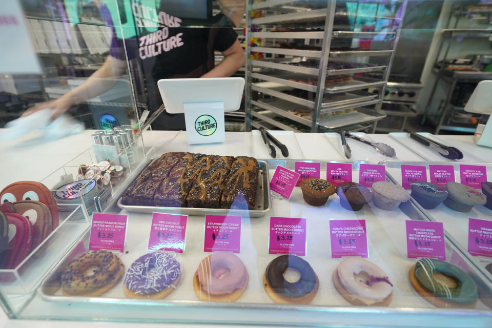 A display counter is filled with mochi donuts and muffins at the Third Culture Bakery in Berkeley, Calif., Thursday, Aug. 19, 2021. From ube cakes to mochi muffins, bakeries that sweetly encapsulate what it is to grow up Asian and American have been popping up more in recent years. Their confections are a delectable vehicle for young and intrepid Asian Americans to celebrate their dual identity. (AP Photo/Eric Risberg)