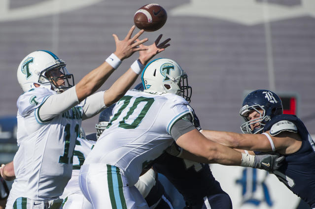 Tulane quarterback Nick Montana (11) reaches for a high snap during the first quarter during the first quarter of an NCAA college football game against Rice at Rice Stadium, Saturday, Nov. 30, 2013, in Houston. (AP Photo/Houston Chronicle, Smiley N. Pool)