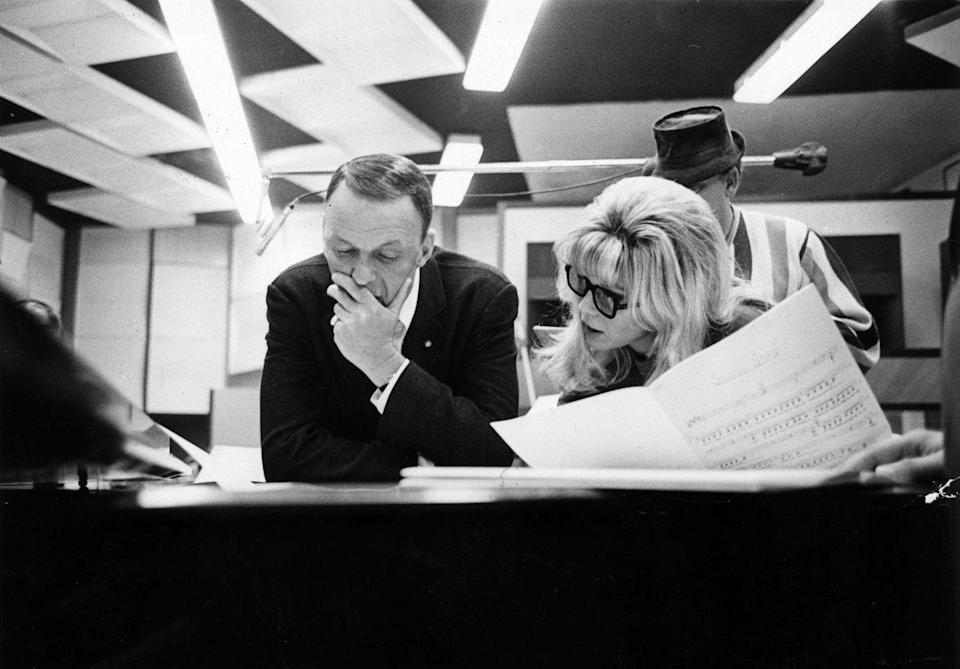 <p>Frank Sinatra discusses a musical interpretation with his daughter Nancy while they work on their first recording together in Hollywood, 1967.</p>