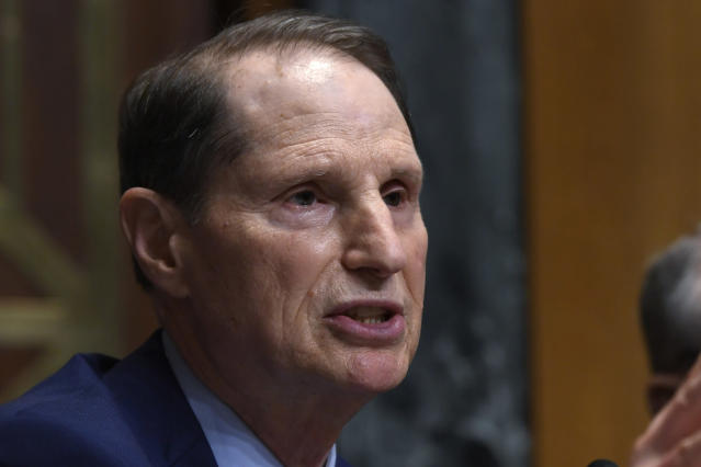 """FILE - In this April 9, 2019 file photo, Senate Finance Committee ranking member Sen. Ron Wyden, D-Ore., speaks during a hearing on Capitol Hill in Washington. A report by Wyden, based on an 18-month investigation by the finance panel's Democratic staff, found that NRA leaders """"engaged in a years-long effort to facilitate the U.S.-based activities"""" of Russian nationals Maria Butina and Alexander Torshin. (AP Photo/Susan Walsh)"""