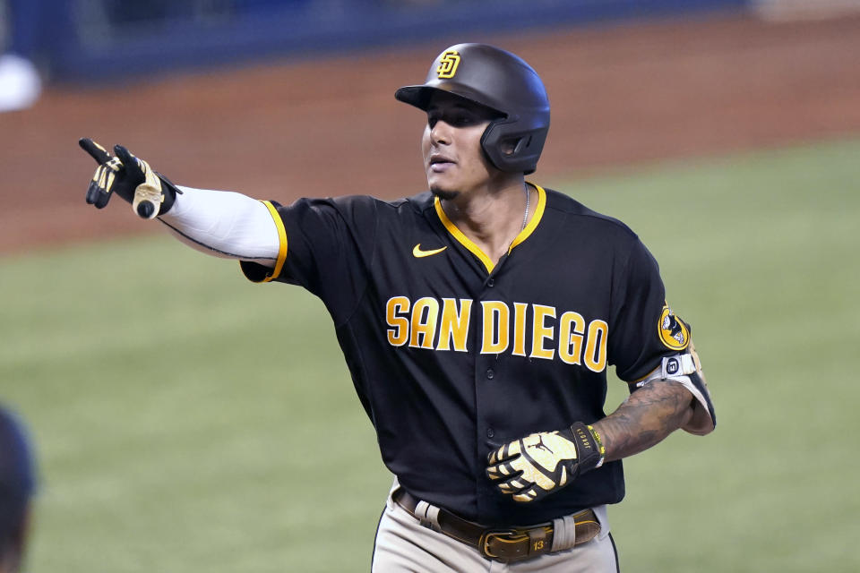 San Diego Padres' Manny Machado reacts after hitting a solo home run during the fourth inning of a baseball game against the Miami Marlins, Sunday, July 25, 2021, in Miami. (AP Photo/Lynne Sladky)