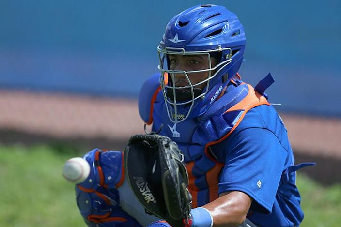 <p>New York Mets catching prospect Carlos Sanchez awaits the pitch during a bullpen session at the Mets spring training facility in Port St. Lucie, Fla., Monday, Feb. 27, 2017. (Gordon Donovan/Yahoo Sports) </p>