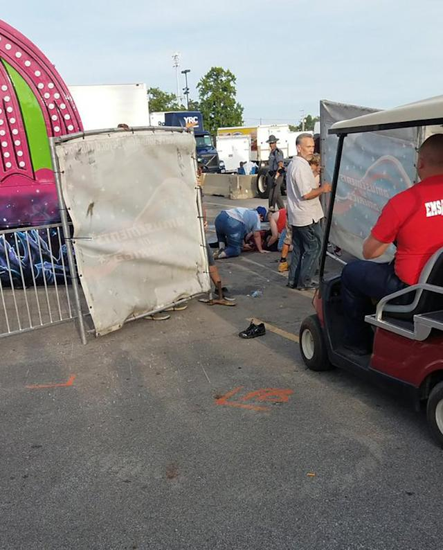 <p>A person is attended to as authorities respond after the Fire Ball amusement ride malfunctioned injuring several at the Ohio State Fair, Wednesday, July 26, 2017, in Columbus, Ohio. Some of the victims were thrown from the ride when it malfunctioned Wednesday night, said Columbus Fire Battalion Chief Steve Martin. (Justin Eckard via AP) </p>