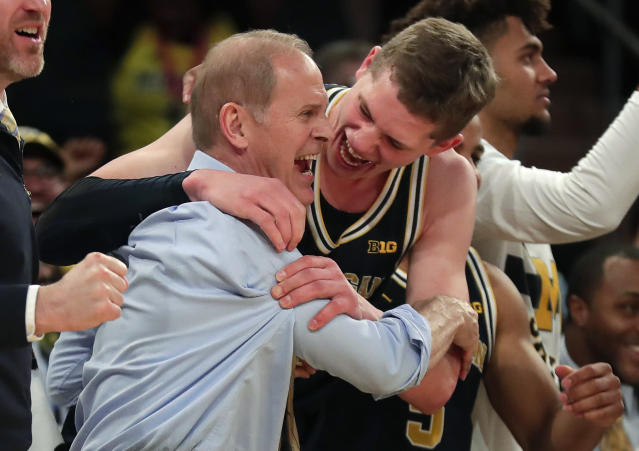 Michigan head coach John Beilein, left, celebrates with Michigan forward Moritz Wagner (13) after Michigan defeated Purdue 75-66 to win the Big Ten tournament. (AP Photo/Julie Jacobson)