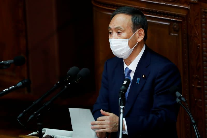 FILE PHOTO: Japanese Prime Minister Yoshihide Suga gives his first policy speech in parliament in Tokyo