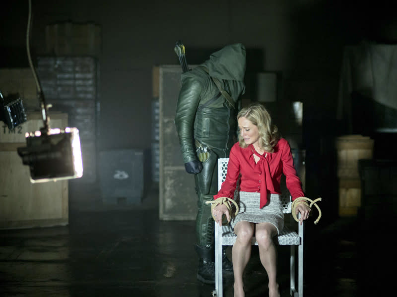 """Darkness on the Edge of Town"" -- Stephen Amell as The Arrow and Susanna Thompson as Moira Queen"
