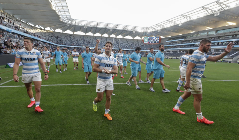 Argentina players wave to the crowd as they celebrate after the Tri-Nations rugby test between Argentina and New Zealand at Bankwest Stadium, Sydney, Australia, Saturday, Nov.14, 2020. Argentina defeated the All Blacks 25-15. (AP Photo/Rick Rycroft)